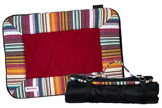 Small dog travel bed in brown and green open and rolled up with strap