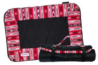 Small dog travel bed in red open and rolled up with strap