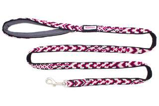 Top view of pink and black dog leash