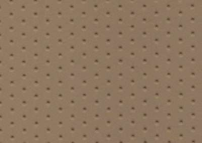 Square swatch of vinyl upholstery in beige dimples pattern