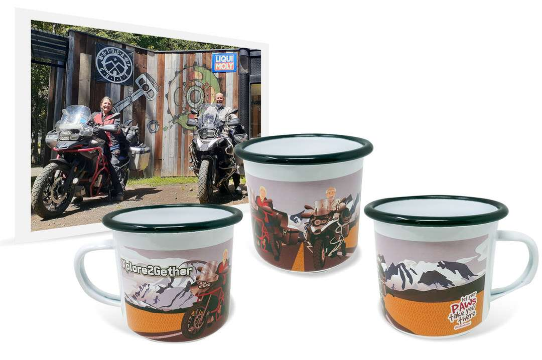 Photo of man and woman on adventure motorcycle beside enamel travel mug with personalized artwork