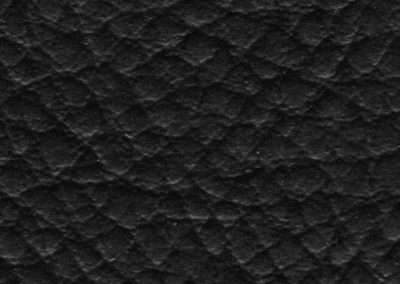 swatch of vinyl upholstery in black fake goatskin