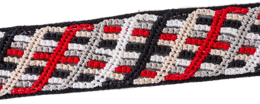 Closeup of thatched pattern red knotted band on black handwoven cotton with reflective ribbon