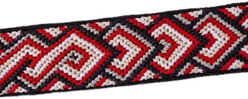 Closeup of diamond pattern red knotted band on black handwoven cotton with reflective ribbon
